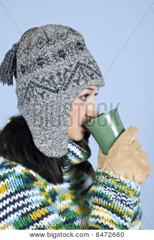 Winter Female Drinking A Cup Of Tea