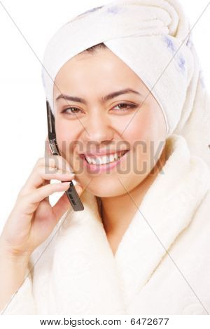 Smiling Woman In Bathrobe With Phone