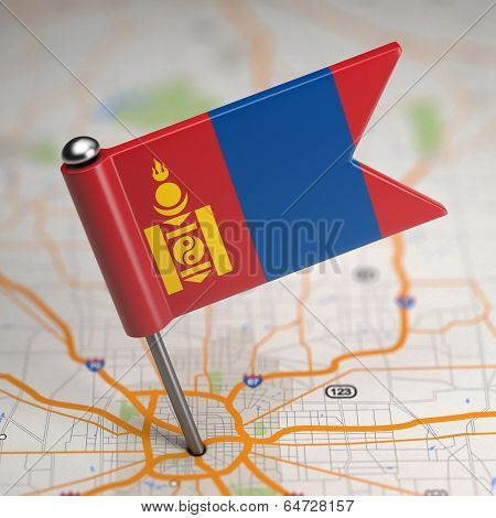 Mongolia Small Flag on a Map Background.