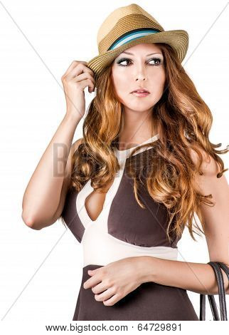 Fashion Portrait Of Woman Wearing Vogue Hat