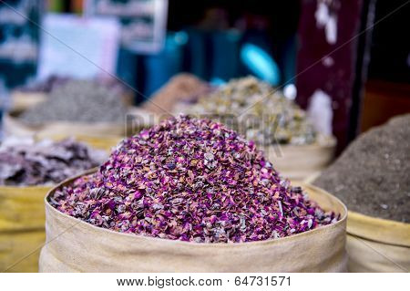 dried herbs flowers spices in Bazaar or souk Khan el-Khalili, and security guard,Cairo, Africa