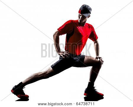 one young man runners joggers stretching warming up in silhouettes isolated on white background