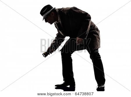 one detective man criminals investigations  investigating crime in silhouettes on white background