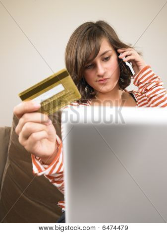 Young Woman Shopping Via Phone