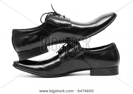 Classic Black Men's Shoes Standing On Each Other
