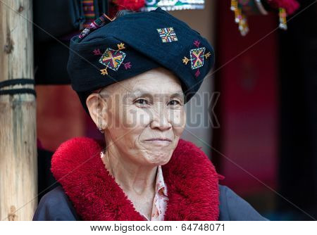 CHIANG RAI, THAILAND - DEC 4, 2013: Unidentified Yao hill tribe woman in traditional clothes. Portrait of female with smile on face. Popular tourist travel tour destination in northern Thailand.