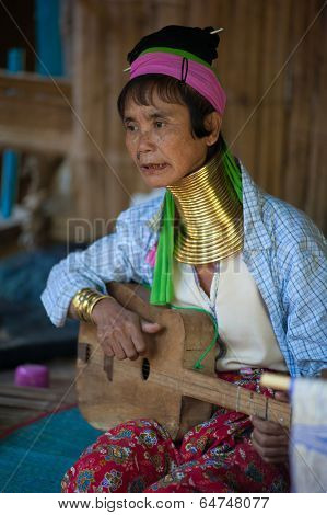 MAE HONG SON, THAILAND - DEC 4, 2013: Unidentified Karen tribal woman in Mae Hong Son, Thailand, Chiang rai, Karen Long Neck hill tribe village. Famous tourist travel destination. Traditional clothes