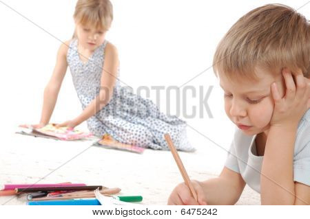 Thoughtful Children Drawing And Reading