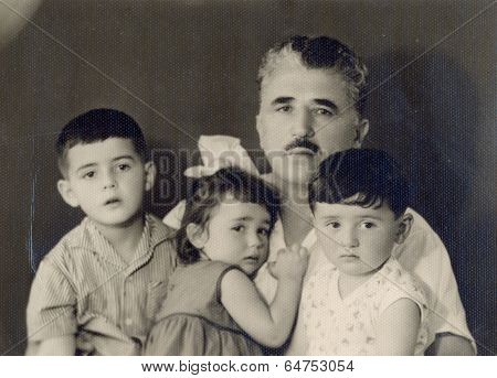 portrait of a Soviet family - father a daughter and two sons.