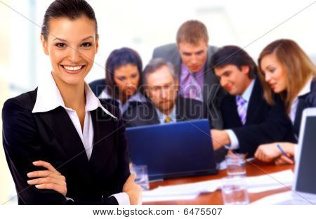 businesswoman with a group behind him