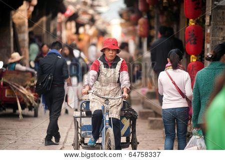 Crowd Walking In Shuhe Ancient Town.