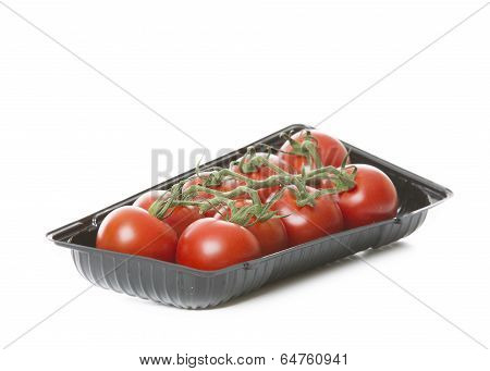 Fresh Tomatoes Isolated On White Background In Black Tray