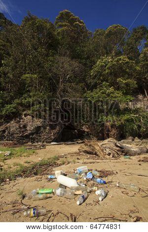 BAKO NATIONAL PARK, MALAYSIA - MAY 09 2014: Plastic pollution on remote tropical beach. Photo shows problem of plastic pollution in oceans, with non-biodegradable plastics drifting onto nature areas.