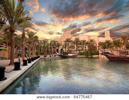 DUBAI, UAE - OCTOBER 25: Beautiful views of Madinat Jumeirah hotel on October 25, 2012 on Dubai, United Arab Emirates. Madinat Jumeirah - luxury 5 star hotel with own artificial canals and boats.