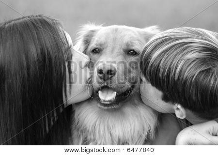 Teenagers Kissing Dog