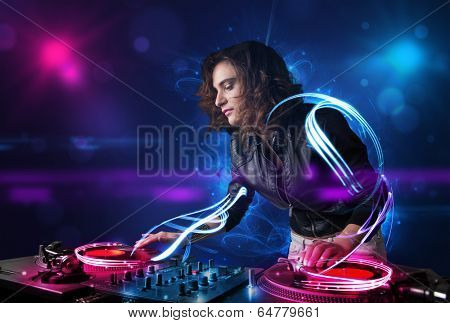 Beautiful disc jockey playing music with electro light effects and lights
