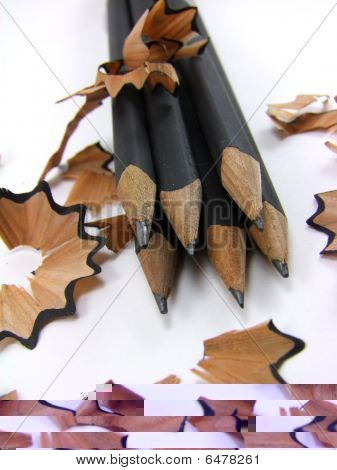 Sharpened pencils with shavings on white background - 2