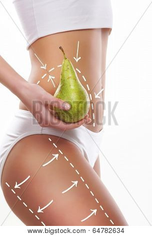 Female body with the drawing arrows on it isolated on white. Woman holding pear. Fat lose, liposuction and cellulite removal concept.