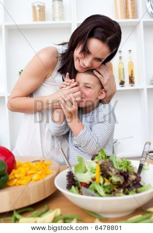 Mother And Her Little Girl Having Fun In The Kitchen