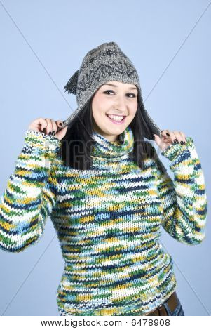 Happy Girl  In Pullover And Wool Cap