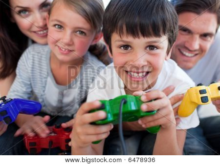 Excited Family Playing Video Games