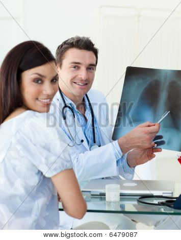 Smiling Doctors Examining An X-ray