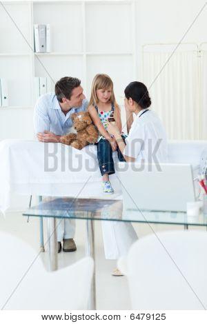 Femal Doctor Giving Medecine To A Patient