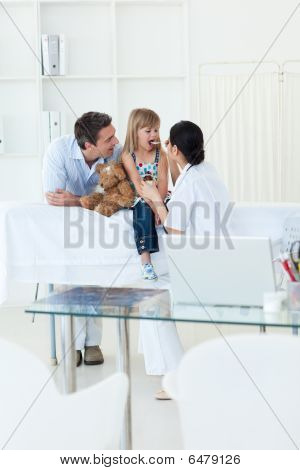 High Angle Of A Doctor Giving Medecine To A Little Girl