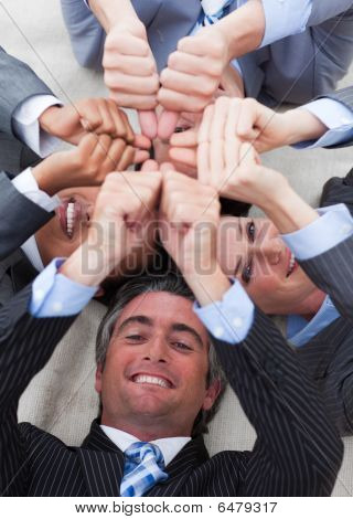 Business Team Lying On The Floor In A Circle