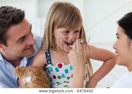 Smiling Doctor Giving Medecine To A Child