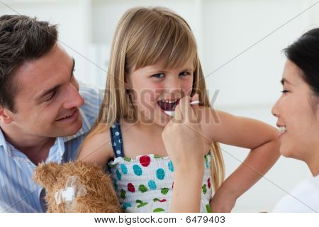 Confident Doctor Giving Medecine To A Little Girl