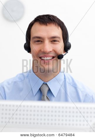 Confident Businessman With Headset On In A Call Center
