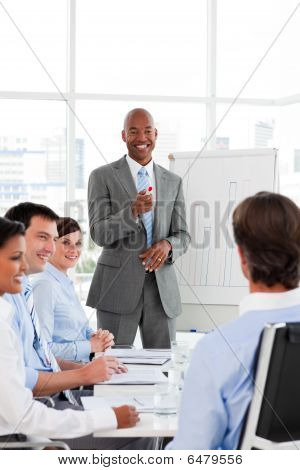 Confident Afro-american Businessman Discussing With His Team