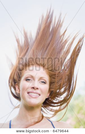 Young Woman Outdoors With Windblown Hair