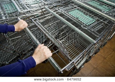 Shopper's Hands Selecting A Shopping Cart