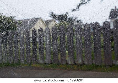 Rural View Through Car Window With Rain Drops