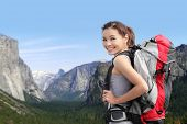 pic of mountain-climber  - Travel in Yosemite Park happy woman mountain hiker with backpack and smile to you California USA - JPG