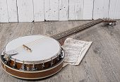 pic of bluegrass  - banjo with some sheets placed on the ground - JPG
