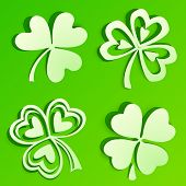 stock photo of triskele  - Green cutout paper vector clovers with shadows - JPG