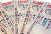 stock photo of indian currency  - A fan of one thousand rupee notes  - JPG
