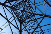 image of electricity pylon  - Electricity pylon against the blue sky background - JPG