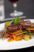 stock photo of swabian  - swabian steak with roasted onion rings and vegetables - JPG