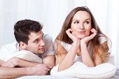 image of shy woman  - A stubborn confident woman and a loving shy man lying in bed - JPG