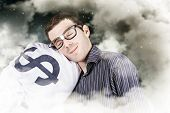 picture of sleeping bag  - Funny finance portrait of a business person sleeping on a money bag in a cloudy haze of stars and sky - JPG