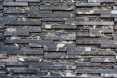 image of slating  - Stacked Slate Stone Wall as horizontal textured background - JPG