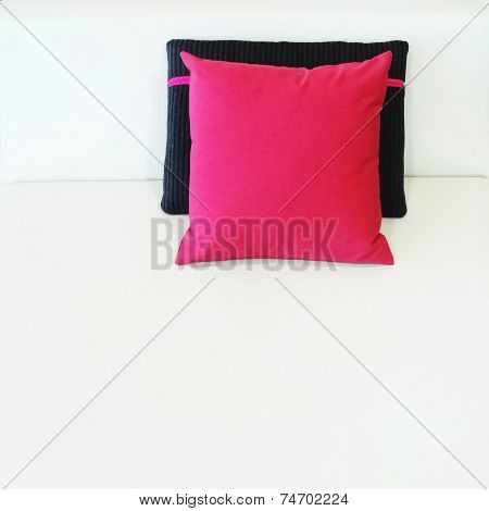 Red And Black Cushions On A Bed