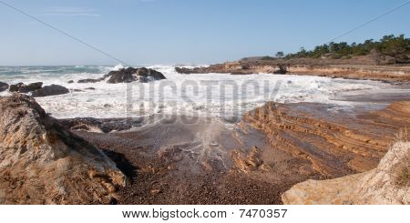 Surf Eroding Coastal Rocks
