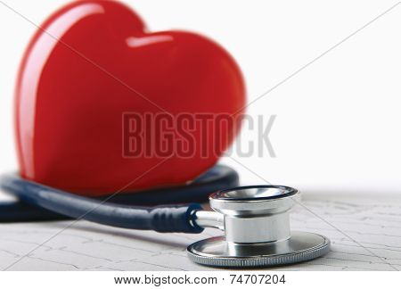 Medical stethoscope and heart isolated on white.