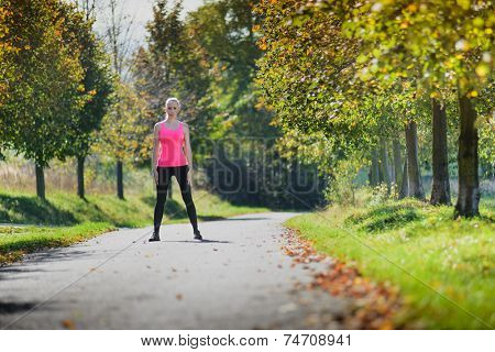 Girl preparing to run at sunny day