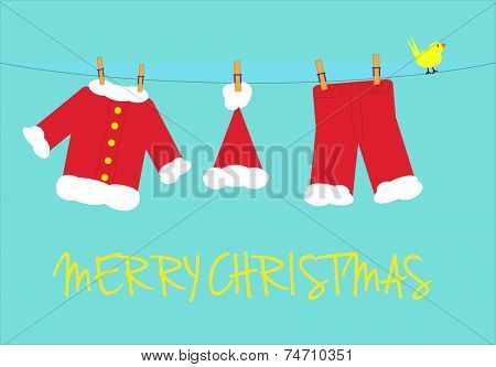 Santa claus clothes and yellow bird on a clothesline with a turquoise background and merry christmas message.